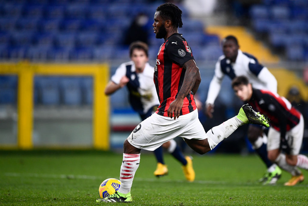 Franck Kessie of AC Milan scores the opening goal from a